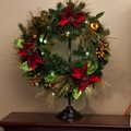 Cypress Heaven and Nature Sing LED Poinsettia Pine Wreath