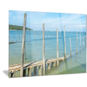 DesignArt 'Wooden Piers by Blue Sea' Photographic Print; 12'' H x 28'' W
