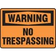Accuform Signs® 7in. x 10in. Plastic Safety Sign in.WARNING NO TRESPASSINGin., Black On Orange