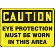 Accuform Signs® 10in. x 14in. Plastic Safety Sign in.CAUTION EYE PROTECTION MUST BE W..in., Black On Yellow