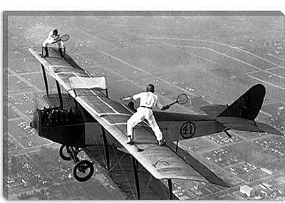 iCanvas Playing Tennis on a Biplane in 1925 Photographic Print on Canvas; 12'' H x 18'' W x 0.75'' D