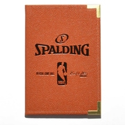 Cahier de notes à couverte de l'équipe de basketball Spalding, orange