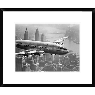 Global Gallery Aircraft Flying over City, 1946 Framed Photographic Print; 18'' H x 22'' W x 1.5'' D