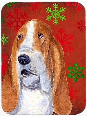 Caroline's Treasures Snowflakes Basset Hound Glass Cutting Board; Red/Green