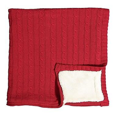 Couverture en tricot sherpa sur cintre en bois, rouge