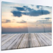 DesignArt 'Wooden Board at Sunset Seashore' Photographic Print on Metal; 12'' H x 28'' W x 1'' D