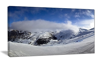 DesignArt 'Winter in Alps Panorama' Photographic Print on Wrapped Canvas; 20'' H x 40'' W x 1'' D
