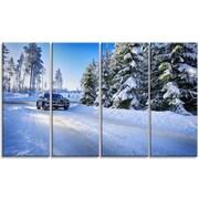DesignArt 'SUV Car Though Snowy Winter' Photographic Print Multi-Piece Image on Canvas