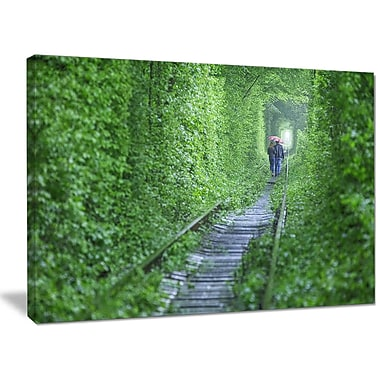 DesignArt 'Couple Walking into Tunnel' Photographic Print on Wrapped Canvas; 30'' H x 40'' W x 1'' D