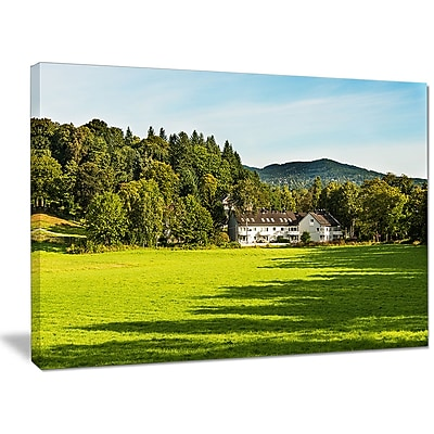 DesignArt 'Alone Farmhouse in Meadow' Photographic Print on Wrapped Canvas; 30'' H x 40'' W x 1'' D