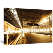 DesignArt 'Train at Railway Station w/ Sunlight' Photographic Print on Wrapped Canvas
