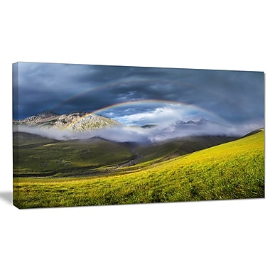 DesignArt 'Rainbow in Mountain Valley' Photographic Print on Wrapped Canvas; 20'' H x 40'' W x 1'' D