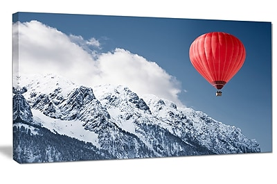 DesignArt 'Balloon Over Winter Hills' Photographic Print on Wrapped Canvas; 20'' H x 40'' W x 1'' D