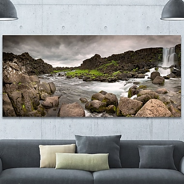 DesignArt 'Dramatic Oxarafoss Waterfalls' Photographic on Wrapped Canvas; 28'' H x 60'' W x 1.5'' D