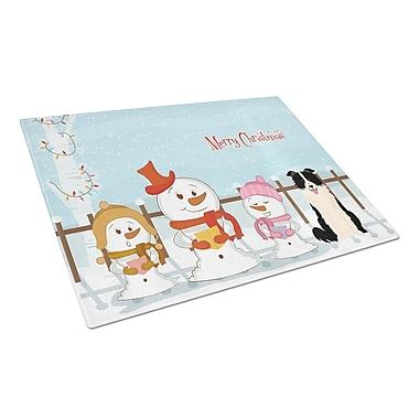 Caroline's Treasures Merry Christmas Carolers Glass Border Collie Cutting Board; Black/White