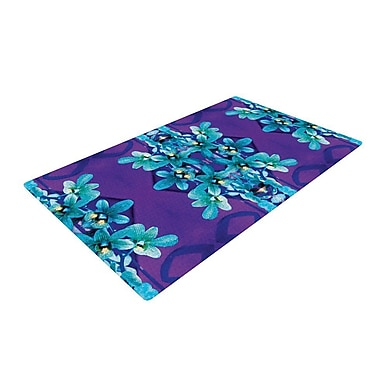 East Urban Home Dawid Roc Blue Orchids Floral Teal Area Rug; 2' x 3'