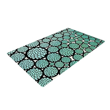 East Urban Home Pom Graphic Design Blooming Trees Circles Turquoise Area Rug; 2' x 3'