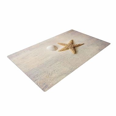 East Urban Home Sylvia Cook Starfish and Shell Beige/Yellow Area Rug; 4' x 6'