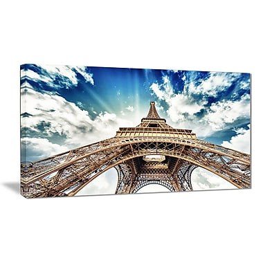 East Urban Home Eiffel Tower w/ Fast Moving Clouds Graphic Art Print on Canvas; 40 '' W x 20 '' H