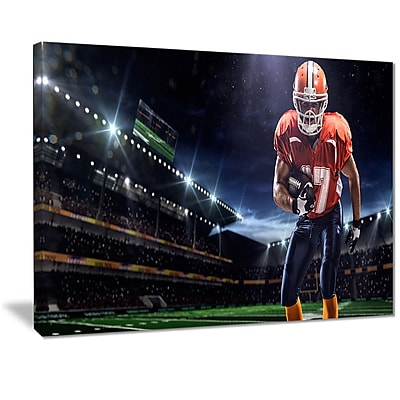 East Urban Home American Footballer in Action on Stadium Graphic Art Print on Canvas