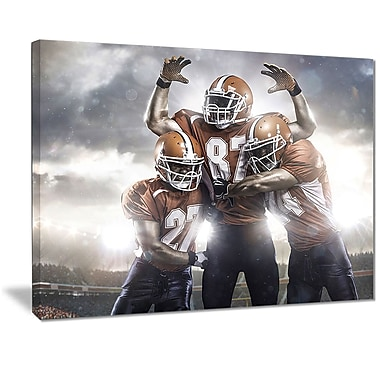East Urban Home American Footballer in Action Graphic Art Print on Canvas; 20 '' W x 12 '' H