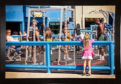 Ebern Designs 'Curiosity, Muscle Beach' Photographic Print; Black Wood Medium Framed Paper