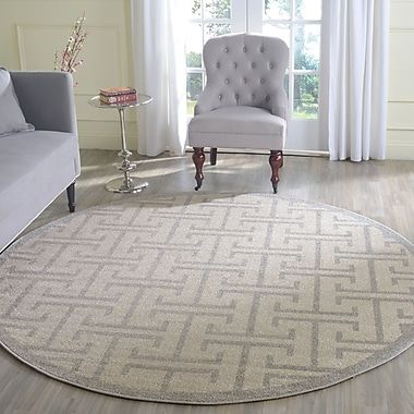 Everly Quinn Fehi Ivory Area Rug; Round 7'
